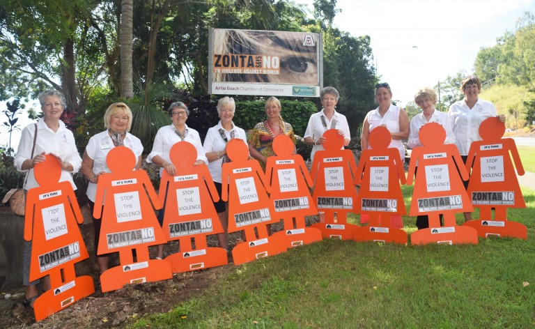ZONTA SAYS NO: Zonta ladies Cath Fernbach, Connie Riley, Maxine Thiele, Sue Hansen, Ann Cleghorn, Lauren Haack, Athena Murray, Joan Watson and Pam Harrison are standing in front of the banner which was erected on Monday morning to support Domestic Violence awareness. Photo Inge Hansen / Whitsunday Times.
